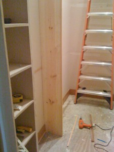 All old stuff ripped out, my one support board to frame the dressing area and divide the load of the shelves along the longest left wall has gone up.