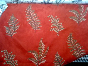 Embroidered Ferns on a Red Ultrasuede... I'm not sure it connects with the rest of the room.