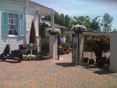 Front Gate - I love the scooter and those great urns on the columns.