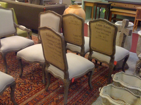 Nice gray linen chairs with an unexpected printed burlap on the back.