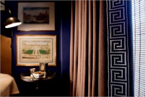 Greek Key trim boosts the linen curtains