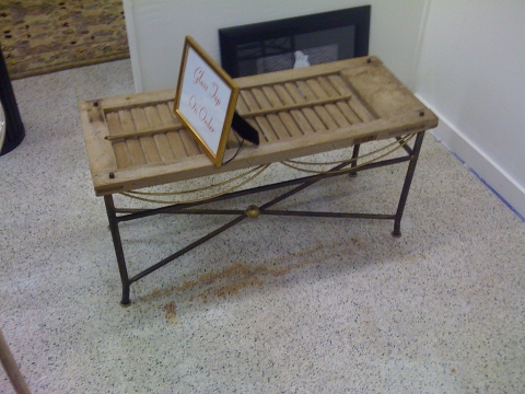 An adorable coffee table made from reclaimed New Orleans shutters. A glass top keeps your wine glass from ruining the rug. A design by Janet Molero, ASID. Cute, no?