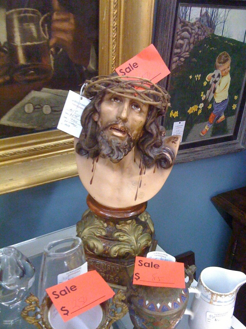 Tortured Jesus with a decorative gold gilt base was on sale! This was actually sitting on a buffet in a dining room vignette. I'll just have a salad, thanks.